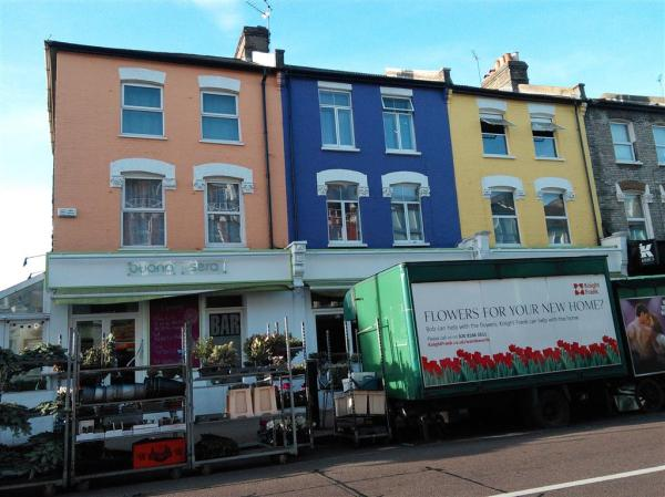 Tobermory-style brightly coloured facades in Northcote Road, Battersea