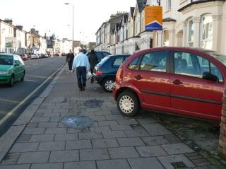 Cars parked on the pavement, Garratt Lane