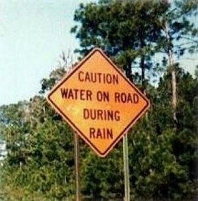 Caution --- Water on Road when Raining